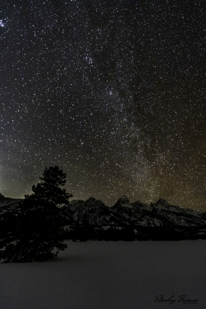 Star-filled sky over the Teton mountain range.  Sony a7R III + 16-35mm lens @ 16 mm, ISO 3200, f/2.8, 25s. ©Stanley Buman. All Rights Reserved.